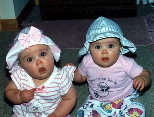 two babies wearing silly hats