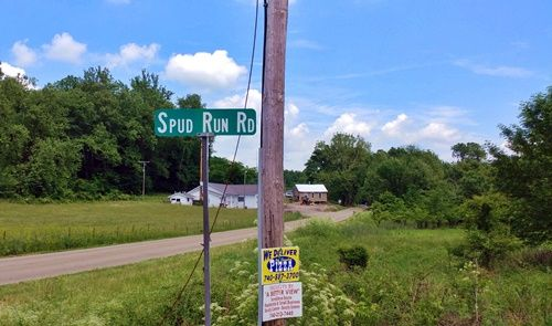Spud-Run-Road sign