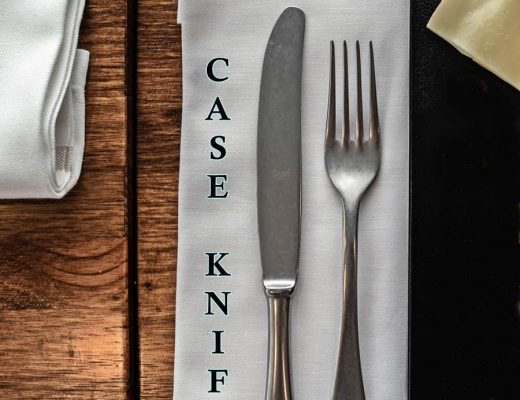 case knife and fork laying on napkin