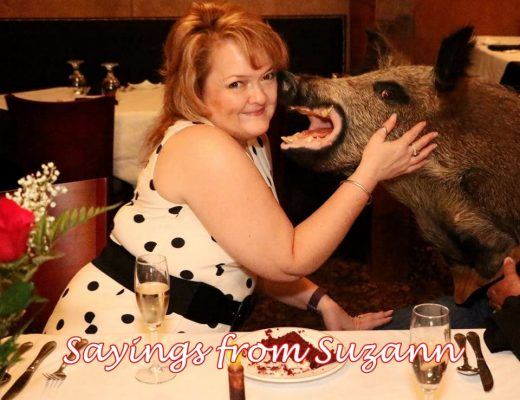 lady petting a stuffed boar