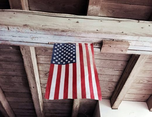 usa flag hanging in barn